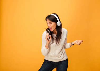 Portrait of a cheerful young woman listening to music