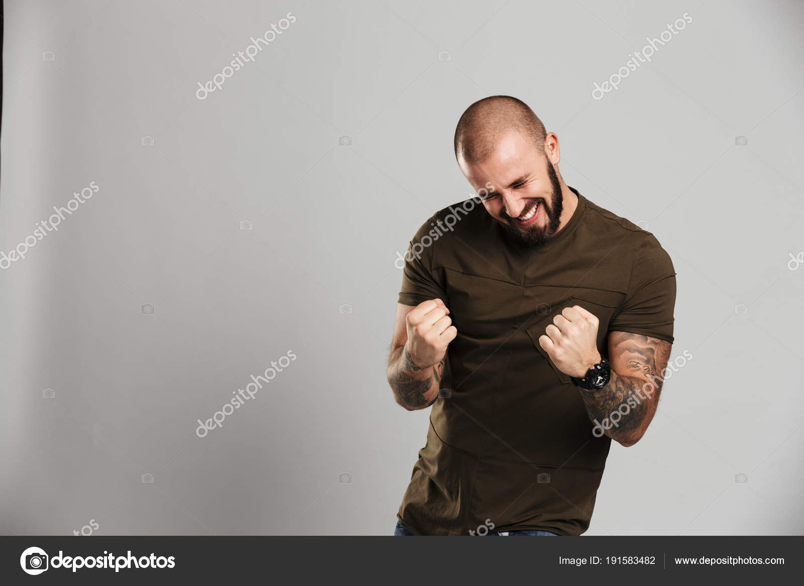 image of happy baldy man with beard and mustache clenching his f