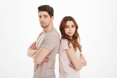 Photo of adult guy and girl wearing beige t-shirts acting like a