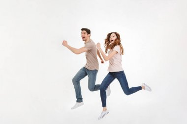 Full-length photo of energetic couple man and woman in casual t-