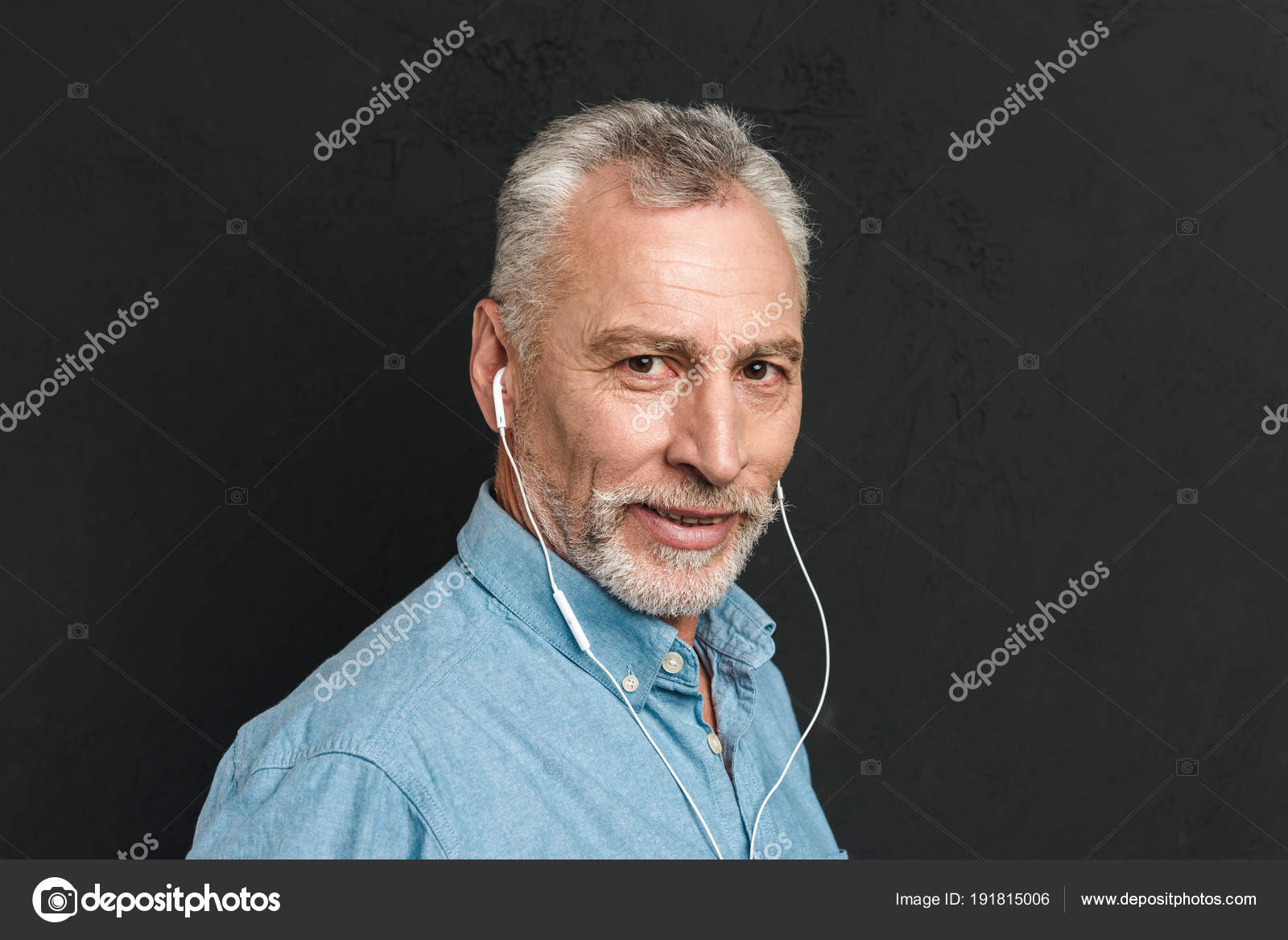 Portrait of handsome mature man 60s with gray hair looking ...