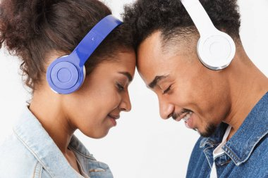 Side view of Smiling lovely african couple in denim shirts