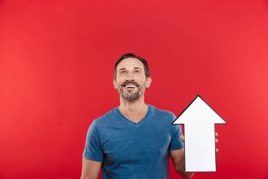 Image of brunette man 30s holding blank speech arrow pointer dir