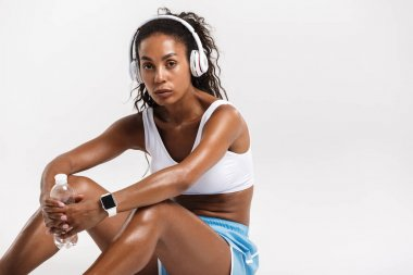 Confident fit young african sportswoman