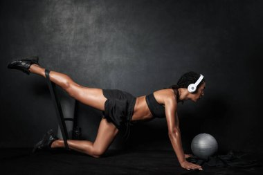 Image of african american woman doing workout with expander equi