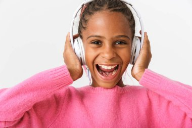 Image closeup of amazed african american girl using headphones