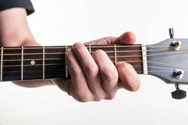 The guitarist's hand clamps the chord C on the guitar, on a white background. Horizontal frame