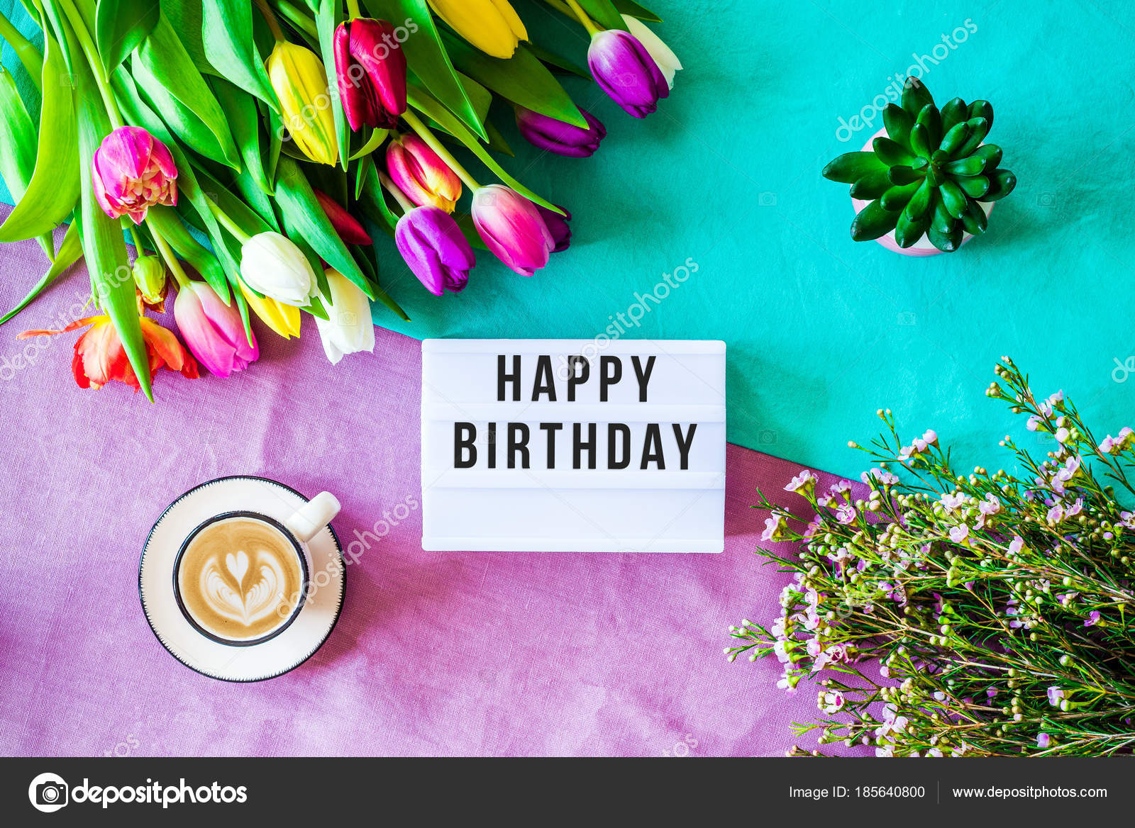 Happy Birthday Written In Lightbox With Spring Flowers From Abov