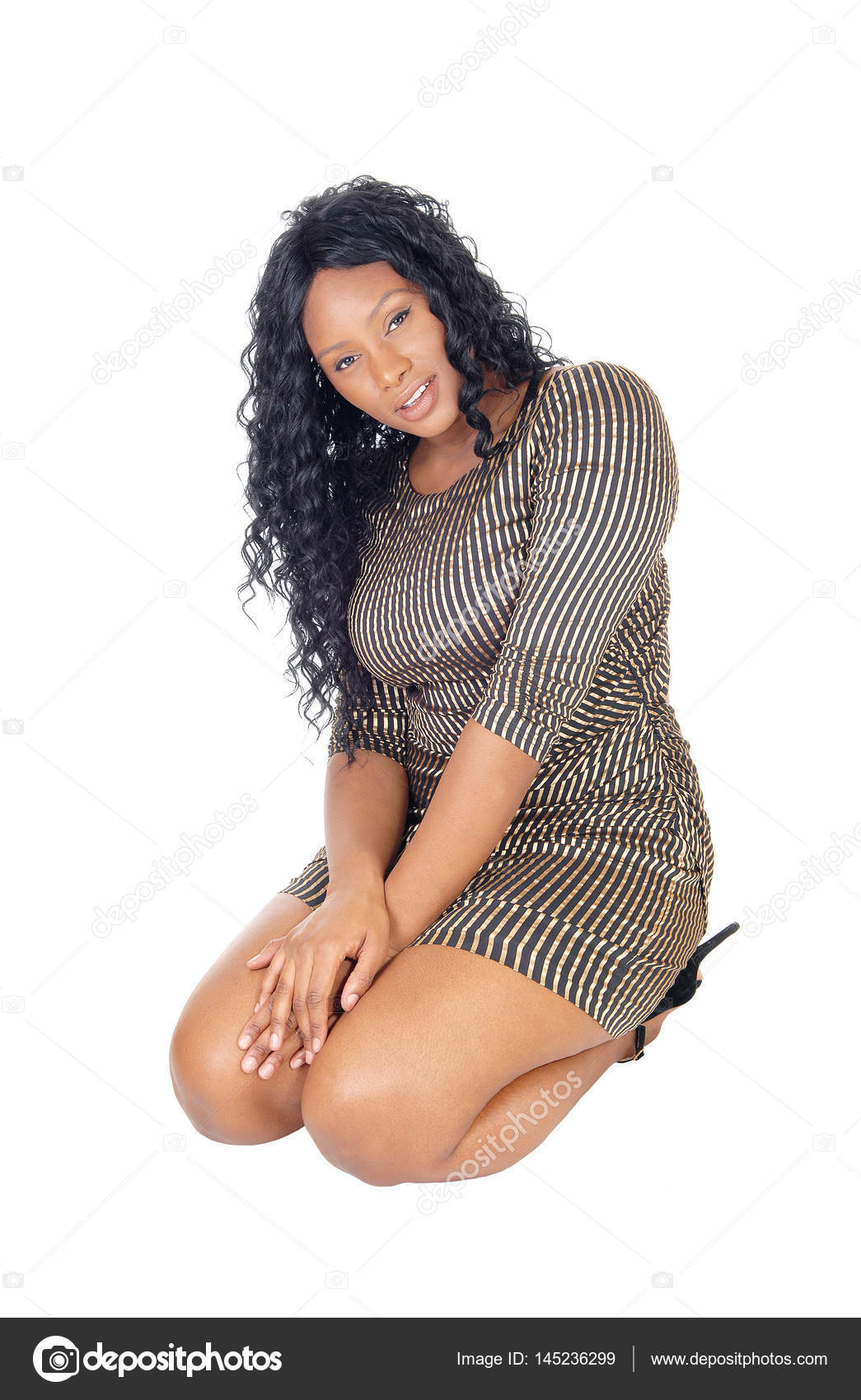 african woman kneeling on floor stock photo sucher 145236299