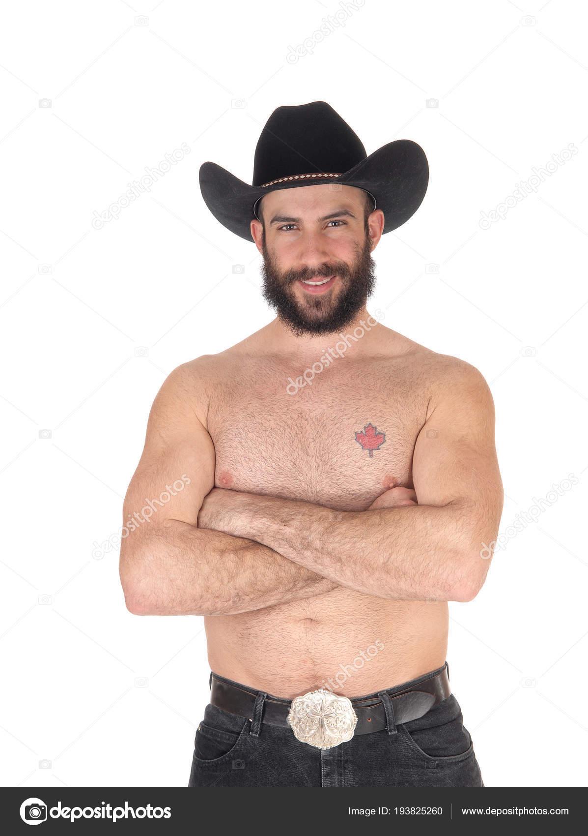 9722d97a7 Camisa hombre con un sombrero de vaquero mirando a la cámara– imagen de  stock