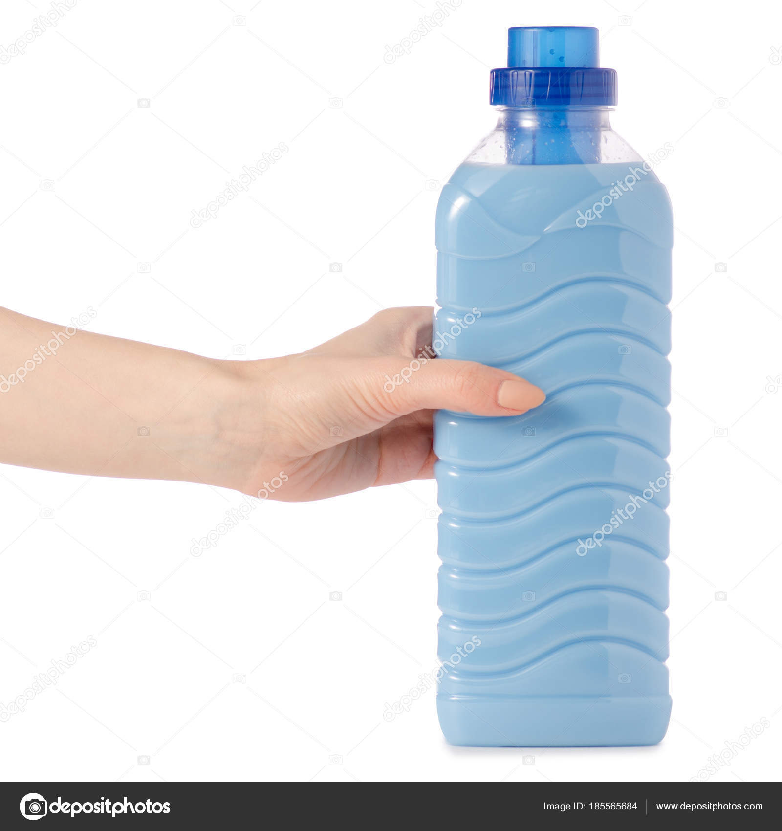Softener Conditioner In Blue Plastic Bottle In Hand Isolated
