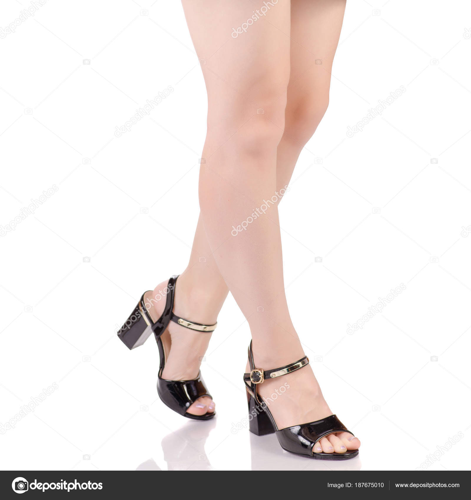 a63b85f7f Female legs in black lacquered shoes sandals beauty fashion buy shop on  white background isolation — Photo by ...