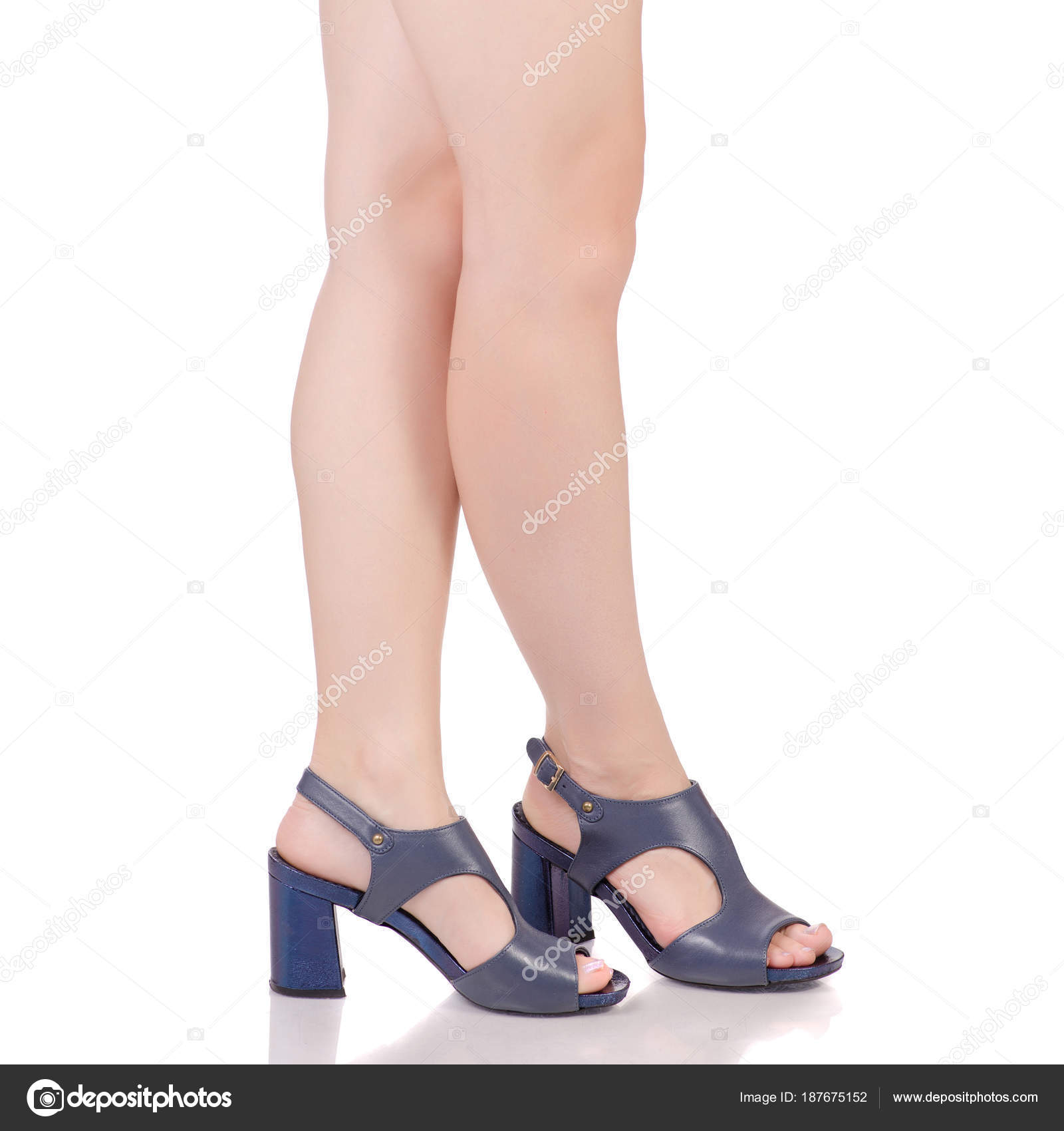 cf787acf7 Female legs in blue leather shoes sandals beauty fashion buy shop on white  background isolation — Photo by ...