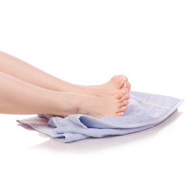 Female feet heel blue bath towel beauty spa