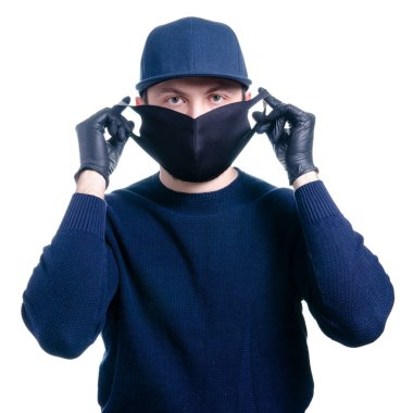 Man in medical protective mask and protective gloves virus