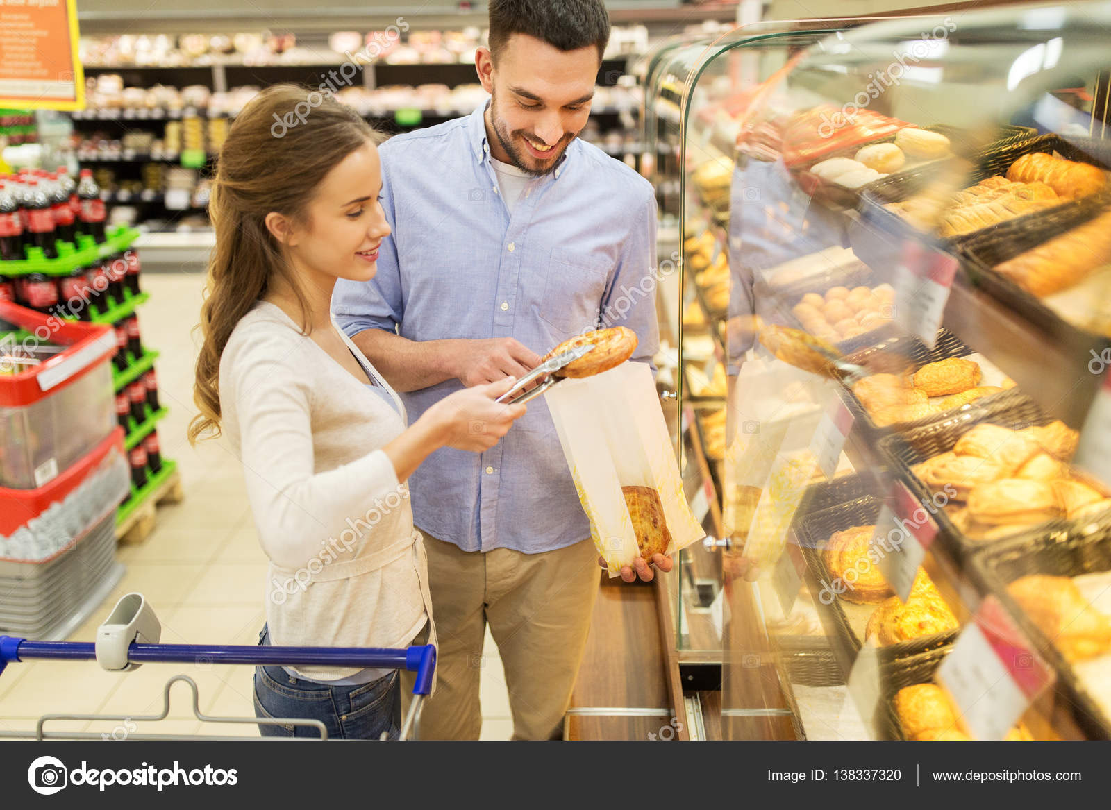Happy Couple With Shopping Cart At Grocery Store Stock