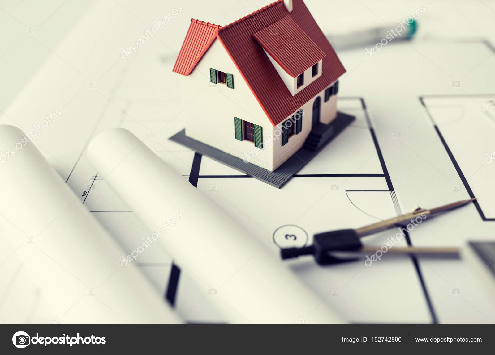 Close up of house model on architectural blueprint stock photo architecture building construction real estate and home concept close up of living house model and compass on blueprint photo by sydaproductions malvernweather Images