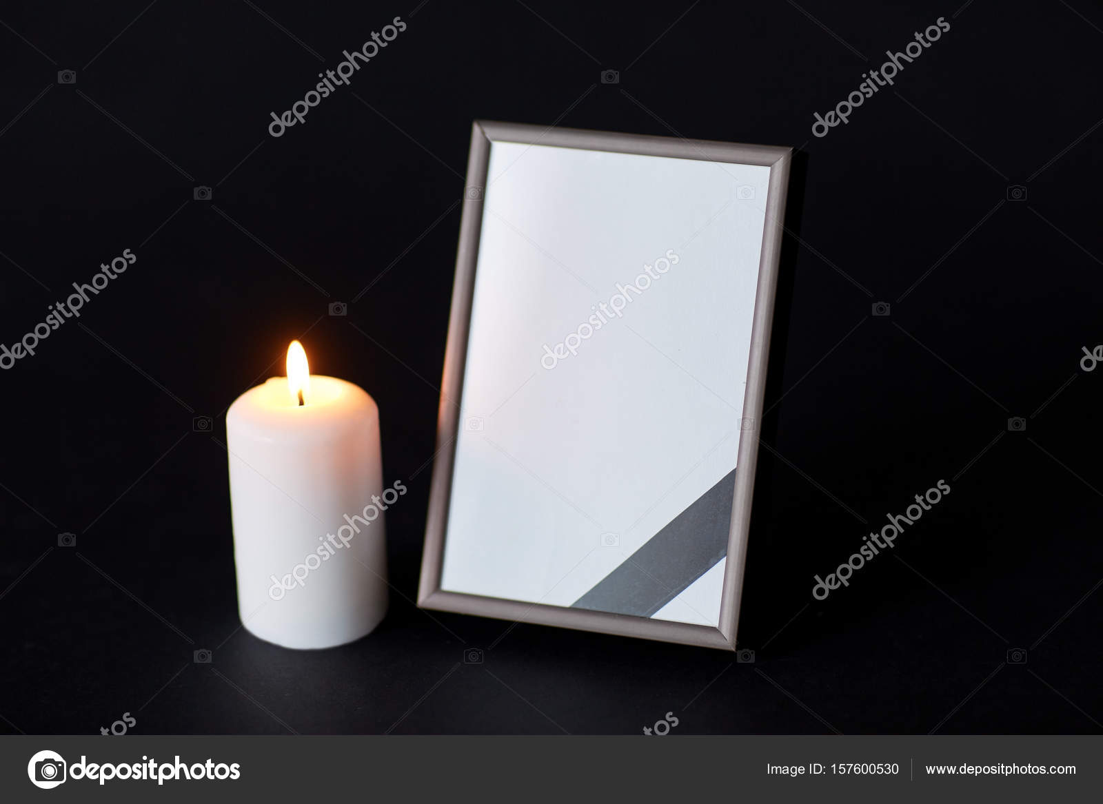 Unique black ribbon on photo frame and candle at funeral — Stock Photo  HM65