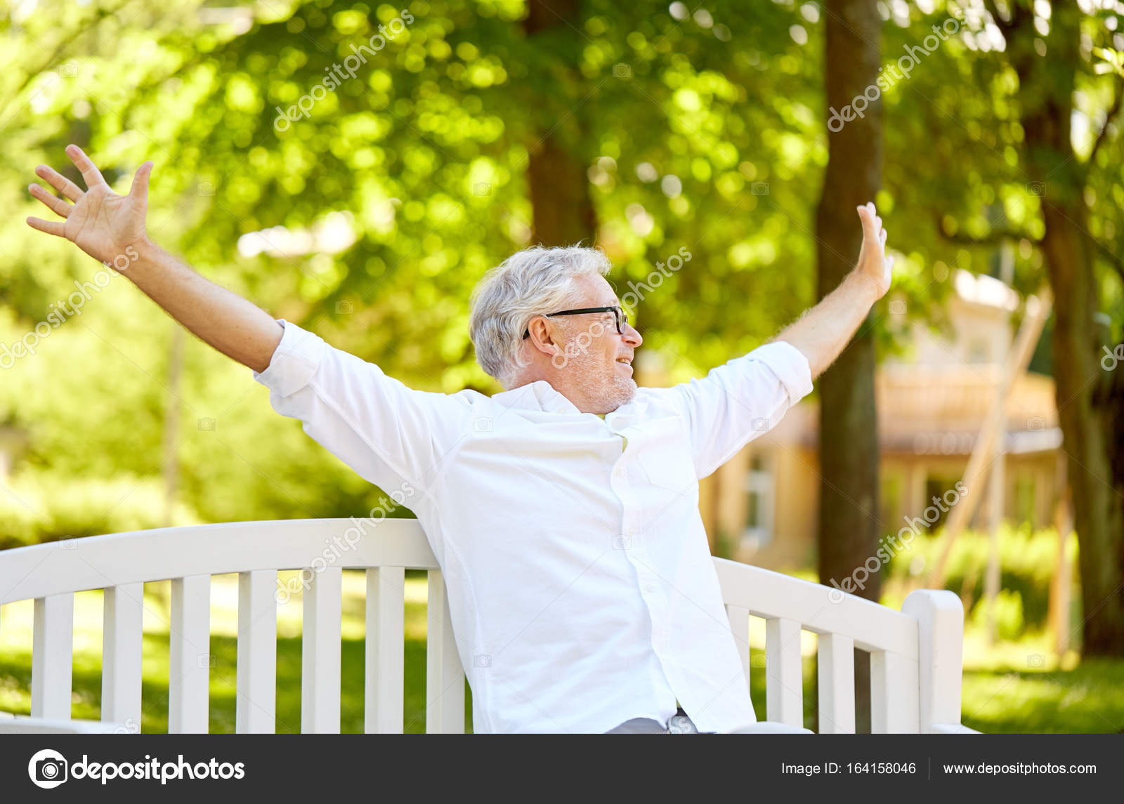 67a040a0f9983 happy senior man sitting on bench at summer park — Stock Photo ...