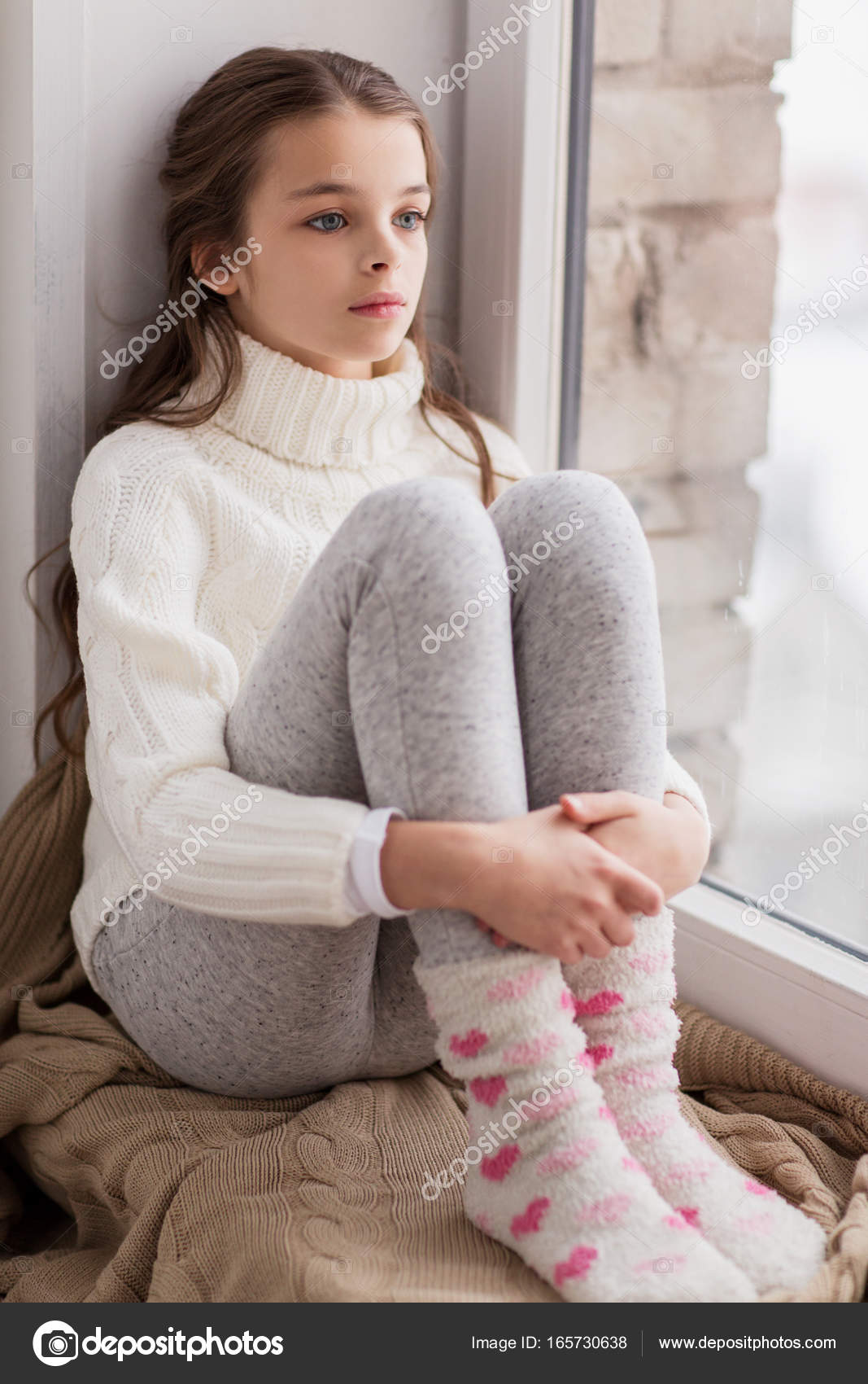 Sad Girl Sitting Alone Outside Stock Photos Sad Girl: Sad Girl Sitting On Sill At Home Window In Winter