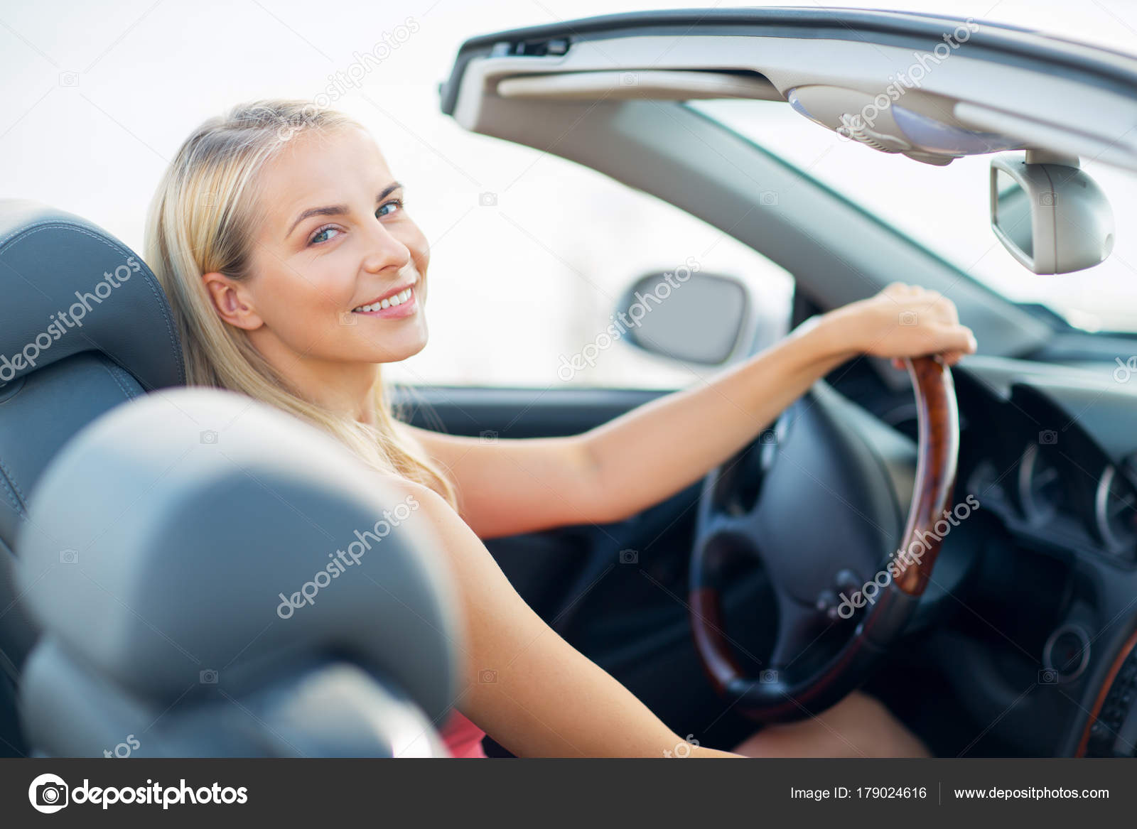 6a8e71998 Happy young woman driving convertible car — Stock Photo ...