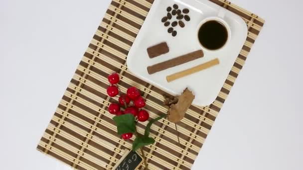 top view spinning video of coffee cup and sweets with branch of cherries