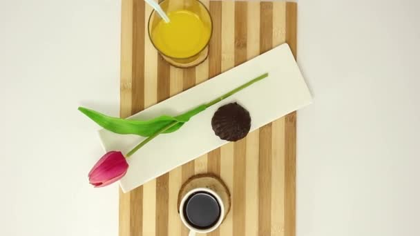 top view spinning video of wooden boars with juice and coffee cup with biscuit