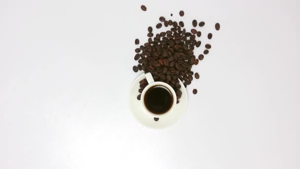 cup of coffee with coffee beans on spinning table background