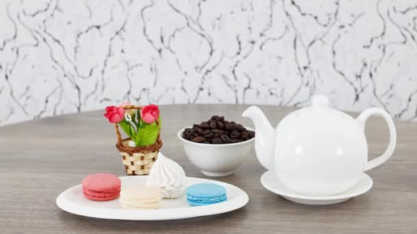 coffee beans with kettle and cookies on wooden table background