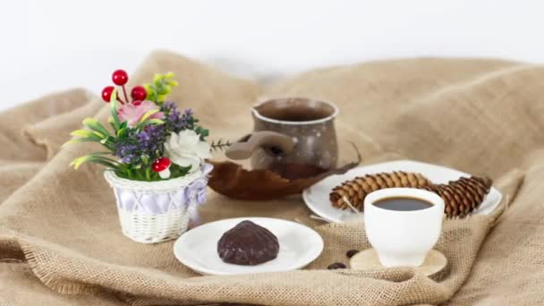 coffee cup with kettle and marshmallow on wooden table background