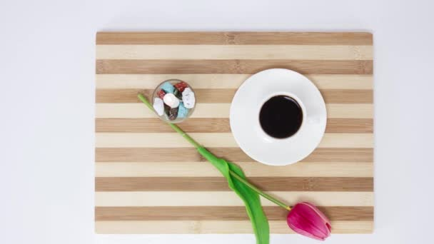 coffee cup with tulip on wooden table background