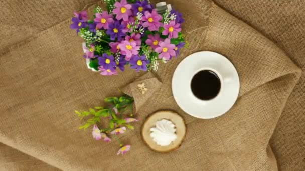 coffee cup with marshmallow on wooden table background