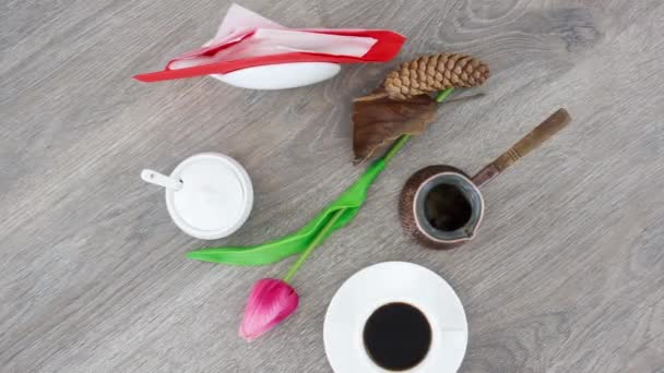 coffee cup with pot and tulip on wooden table background