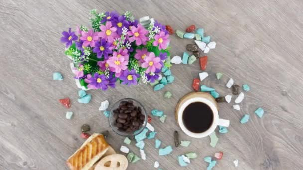 coffee cup with sweets on table background