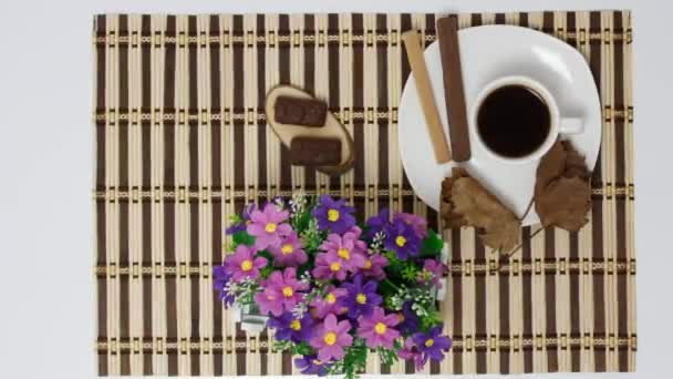 cup of black coffee with sweets on table background