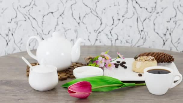 coffee cup with sweets and kettle on wooden table background