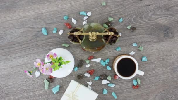 cup of black coffee with colored rocks and justice scales on wooden table background