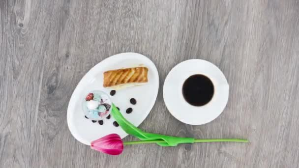 cup of coffee with sweets on wooden table background