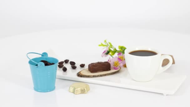 coffee cup with sweets on wooden table background