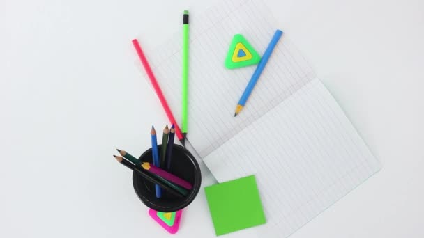 work tools and office supplies on white wooden spinning table background