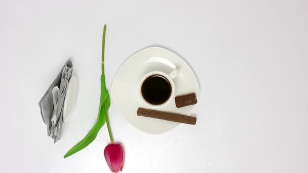 coffee cup with candies on wooden table background
