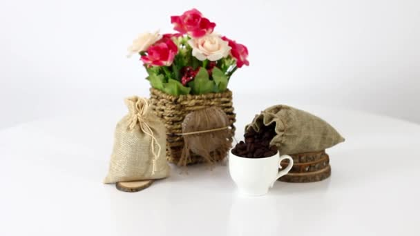Coffee beans and flowers on white background