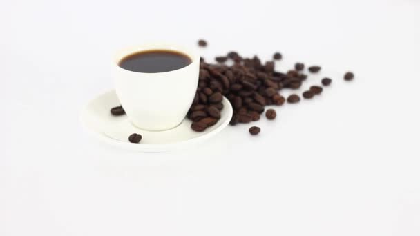 Coffee cup with coffee beans on wooden table background.