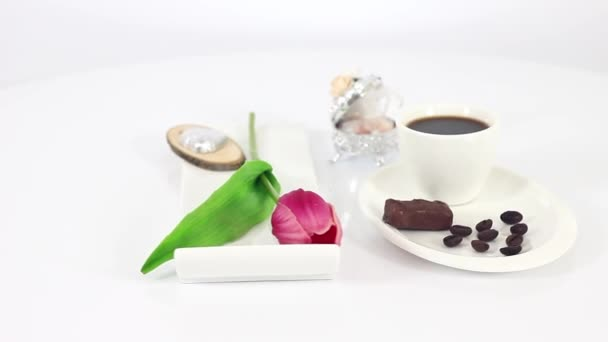 black coffee cup with tasty sweets on wooden table background