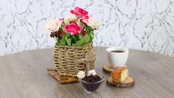 delicious sweets with coffee cup on wooden table background