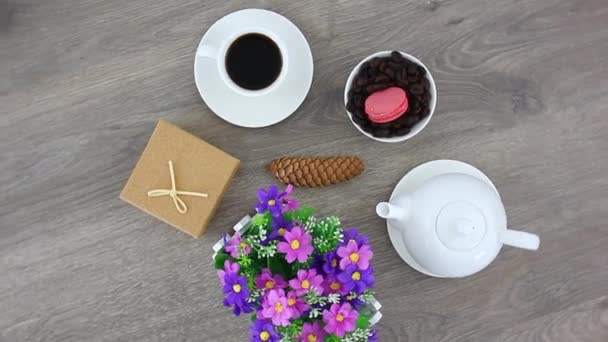 strong black coffee cup with tasty sweets on wooden table background