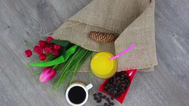 coffee cup with juice glass and coffee beans on wooden table background