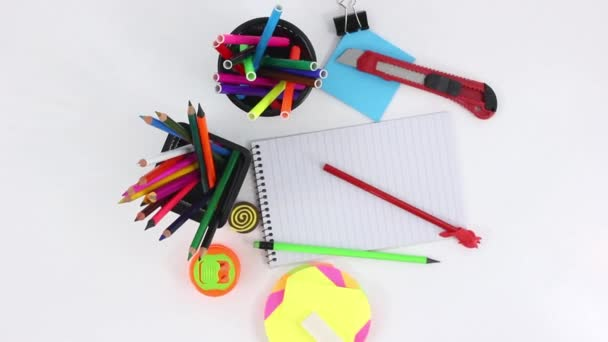 colored office supplies on white wooden spinning table background