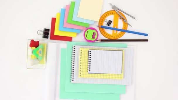 office and school supplies on white table background