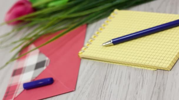 office and school supplies on wooden table background